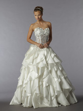 Style 32657249  This ball gown features a sweetheart neckline with a natural waist in silk satin and beaded embroidery. It has a chapel train. This gown is Exclusive to Kleinfeld Bridal.