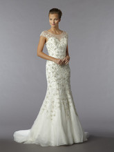 Style 32780819  This sheath gown features an illusion neckline with in beaded embroidery and tulle. It has a chapel train and cap sleeves. This gown is Exclusive to Kleinfeld Bridal.
