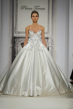 Style 32813750  This ball gown features a sweetheart neckline with a natural waist in silk satin and beaded embroidery. It has a chapel train. This gown is Exclusive to Kleinfeld Bridal.
