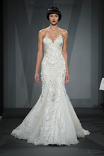 Style 32996985  This mermaid gown features a sweetheart neckline with in satin. It has a chapel train. This gown is Exclusive to Kleinfeld Bridal.