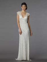 Style 32871477  This sheath gown features a v-neck neckline with a dropped waist in beaded lace and silk satin. It has a chapel train and cap sleeves. This gown is Exclusive to Kleinfeld Bridal.