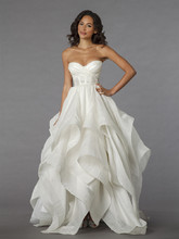 Style 33029398  This ball gown features a sweetheart neckline with an empire waist in organza. It has a chapel train. This gown is Exclusive to Kleinfeld Bridal.