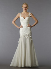Style 33002957 This sheath gown features a sweetheart neckline with a dropped waist in lace. It has a sweep train and cap sleeves. This gown is Exclusive to Kleinfeld Bridal.