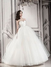 Style 32848202  This ball gown features a sweetheart neckline with an empire waist in tulle and satin. It has a chapel train. This gown is Exclusive to Kleinfeld Bridal.