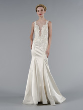 Style 33029034  This sheath gown features an illusion neckline with in silk satin and embroidery. It has a chapel train and a tank top. This gown is Exclusive to Kleinfeld Bridal.