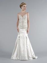 Style 32943664  This mermaid gown features a sweetheart neckline with in silk satin and beaded embroidery. It has a chapel train and spaghetti straps. This gown is Exclusive to Kleinfeld Bridal.