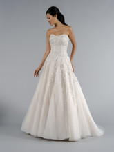 Style 32943672  This a-line gown features a sweetheart neckline with in tulle and beaded embroidery. It has a chapel train. This gown is Exclusive to Kleinfeld Bridal.