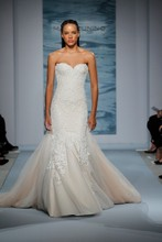 Style 107  Nude illusion strapless gown with ivory corded lace side panels and flounce