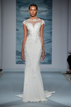 Style 104  Illusion cap sleeve gown with sheer side and back panels embellished with embroidered lace