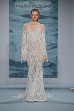 Style 114  White beaded net with long sleeves and train with a nude underlay