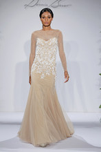 Style Allure  Long Sleeve Nude Netting with white hand beaded symmetrical patterns on sheath gown with flounce at bottom