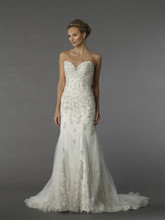 Dennis Basso 14049  This a-line gown features a sweetheart neckline with a natural waist in chiffon and beaded embroidery. It has a chapel train.