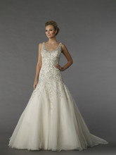 Danielle Caprese 113071 This a-line gown features a v-neck neckline with in chiffon and beaded embroidery. It has a chapel train and a tank top.