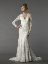 Danielle Caprese 113077  This sheath gown features a v-neck neckline with a natural waist in lace. It has a chapel train and long sleeves.