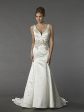 Danielle Caprese 113079  This a-line gown features a v-neck neckline with a natural waist in satin. It has a chapel train and a tank top.