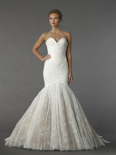 Mark Zunino 95  This mermaid gown features a sweetheart neckline with a dropped waist in lace. It has a chapel train.