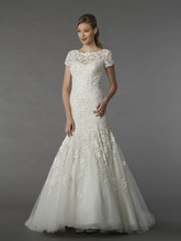 MZ2 74557  This mermaid gown features an illusion neckline with a dropped waist in embroidery and tulle. It has a sweep train and cap sleeves.