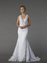 Pnina Tornai 4372  This sheath gown features a v-neck neckline with a natural waist in lace. It has a chapel train and a tank top. This gown is Exclusive to Kleinfeld Bridal.