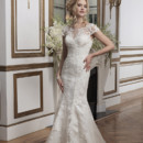 Style 8794  Embroidered lace and tulle fit and flare accentuated with a sabrina neckline.