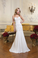 Style 8731 Bugle beads, crystal and pearl covered bodice with a sweetheart neckline on a chiffon fit and flare gown. The gown is finished with chiffon covered buttons over back zipper and a chapel train.