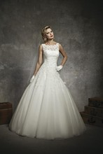 8630 Sabrina sleeveless alencon lace neckline, lace drop waist, circular cut tulle with floating appliques, v back neckline, with buttons over back zipper, chapel length train.