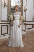Style 8799  Beaded embroidery and chiffon ball gown with a portrait neckline.