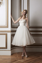 Style 8800  Regal satin and tulle tea length ball gown accented by a sweetheart neckline.
