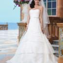Sincerity Style No. 3849  Organza, matte satin A-line dress adorned by a strapless neckline