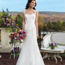 Style # 3802 Chiffon and embroidered beaded lace fit and flare gown which features a Queen Anne neckline and delicate floating appliques throughout the skirt. The gown is finished with an illusion back, chiffon covered buttons over the back zipper and a chapel length train.