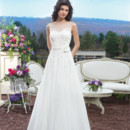 Style # 3807 Marquise beaded Venice lace and chiffon A-line gown with a Sabrina illusion neckline and detachable floral belt. The gown is finished with chiffon buttons over the back zipper and a chapel length train.
