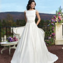 Style # 3810 Matte satin ball gown featuring box pleats, a bateau neckline and an embroidered and beaded detachable matte satin belt.The back is finished with a V-back and satin covered buttons to the end of the chapel length train.