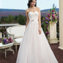 Style # 3816 Tulle and beaded Alencon lace ballgown with a sweetheart neckline. The gown is finished with a satin belt at the natural waist with a bow detail, satin covered buttons over the back zipper and a chapel length train.