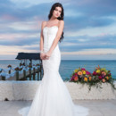 Spring 2014 Style #3780 Acklins Sizzler - Chiffon ruched asymmetrical mermaid gown features beaded sweetheart neckline and center bodice. Style is finished with a lace up back and a chapel length train. Available colors : Ivory, White