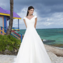 Spring 2014 Style #3782 Organza A-line gown features asymmetrical pleated portrait neckline and bodice. Gown is finished with chapel length train and organza buttons cover back zipper.