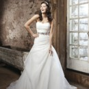 Style #3711 Strapless sweetheart organza asymmetrical draped A-line with buttons over the back zipper. Beaded belt included with organza tie, chapel length train. Available dress only as 3717.