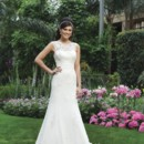 Style #3730 A lace and tulle sheer Sabrina neckline and a chiffon cummerbund, complement the chiffon A-line skirt, that is accented with beaded lace appliqués. This style has a V-back and fabric buttons that cover the back zipper and a chapel length train.