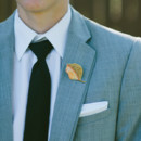 Groom and Groomsmen Attire: Savvi Formalwear