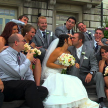 220x220 sq 1415730445553 wedding party kiss