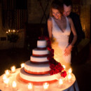 The newlyweds cutting their Italian wedding cake.