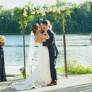 130x130 sq 1525105834 1511452fd8cd5618 bride and groom kissing under arch