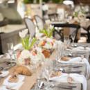 Venue: Olive Boutique Hotel  Floral Designer: Black Flowers and Event Designs by Hiram Colon  Caterer: Oliva Restaurant