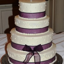 220x220 sq 1421095775136 wedding cake plum ribbon