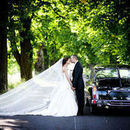 130x130 sq 1460041376 453c76692a66b848 1432046821846 bigstock bride and groom in car 49996160