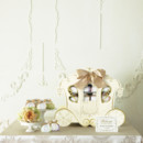 Beautiful favor boxes with pair of delicious cookies sitting in the stunning horse carriage can definitely a feature at your wedding!