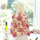 Beautiful floral welcoming tower can make your reception more stylish and elegant. Enhance the venue with this eye-catching feature at your event, you guests would be in love with it. People then could take home a flower of blessing after the party.