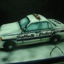 130x130 sq 1329064845198 policecar3