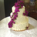 130x130 sq 1289240889941 weddingcakepurpleflowers