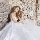 8506  Ivory Tuileries Organza bridal ball gown, strapless sweetheart neckline, draped bodice, cascade skirt, tulle underlay, sweep train.