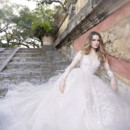 8515  Rose embroidered Nude tulle bridal gown, low V-neckline with long sheer sleeve, natural waist, sweep train.