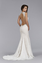 Style JH8453  Ivory Cashmere Alencon lace Fit and Flare bridal gown, sheer embroidered crystal neckline, low open back, gored skirt, sweep train.